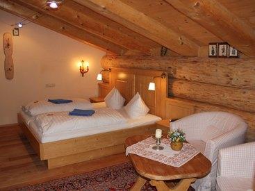 Schlazimmer Naturstammhaus