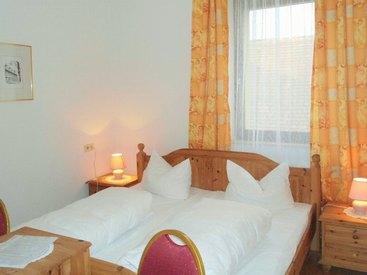 Schlafzimmer im Apartmenthaus des Hotel Krone in Gößweinstein