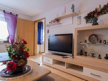 """Wohnzimmer mit Flat-TV """"Püttlachtal"""""""