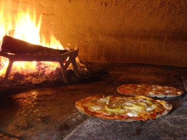 Unsere Holzofen Pizza - ein wahrer Hochgenuss.