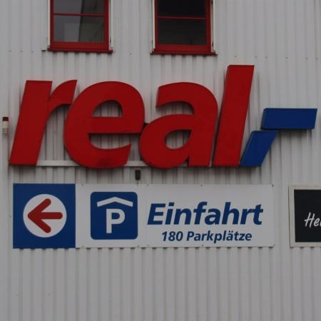 real,- Markt