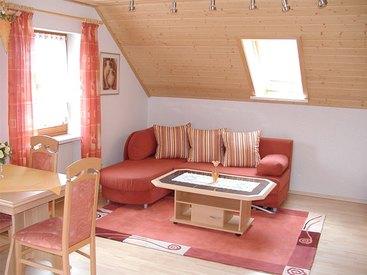 Wohnzimmer der Ferienwohnung Schultheiß