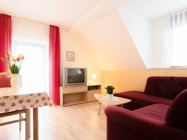Wohnzimmer in der Ferienwohnung 4 im Fritzerhof in Kleingesee bei Gößweinstein in der Fränkischen Schweiz