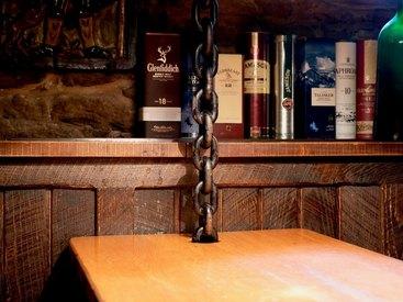 Treffen Sie sich mit Freunden auf einen gemütlichen Abend in unserem Irish Pub